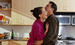 photo of couple hugging in kitchen